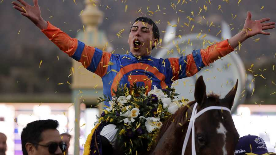 Irad Ortiz Jr. aboard Vino Rosso celebrates after winning the Breeders' Cup Classic horse race at Santa Anita Park, Saturday, Nov. 2, 2019, in Arcadia, Calif.(AP Photo/Gregory Bull)