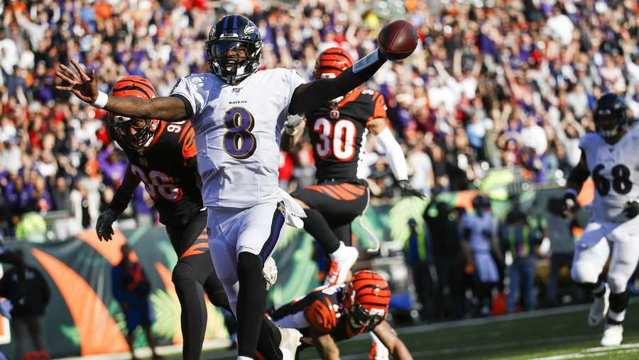 Baltimore Ravens quarterback Lamar Jackson (8) celebrates his touchdown during the second half of NFL football game against the Cincinnati Bengals, Sunday, Nov. 10, 2019, in Cincinnati. (AP Photo/Frank Victores)