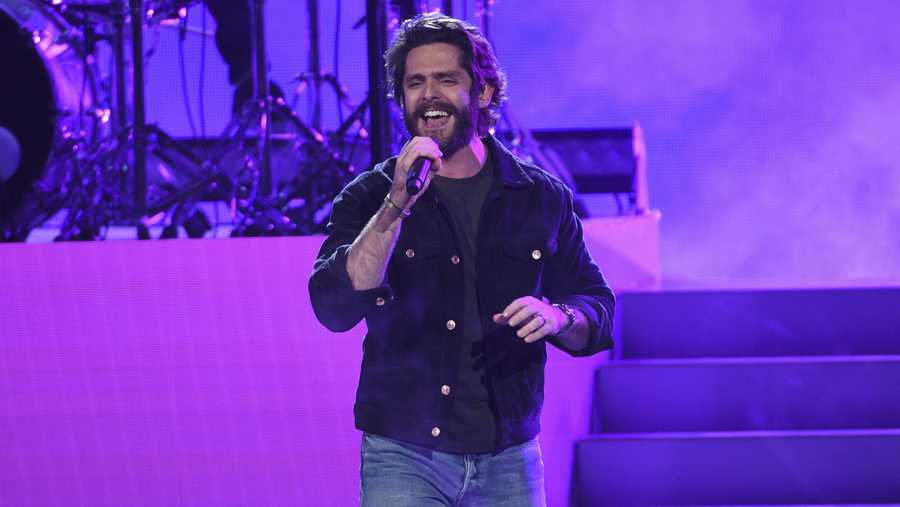 "Thomas Rhett performs ""Look What God Gave Her"" at the American Music Awards on Sunday, Nov. 24, 2019, at the Microsoft Theater in Los Angeles. (Photo by Chris Pizzello/Invision/AP)"