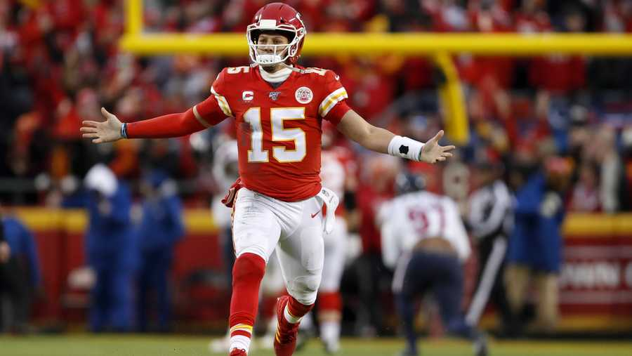 Kansas City Chiefs quarterback Patrick Mahomes celebrates after throwing a touchdown pass during the second half of an NFL divisional playoff football game against the Houston Texans, in Kansas City, Mo., Sunday, Jan. 12, 2020.
