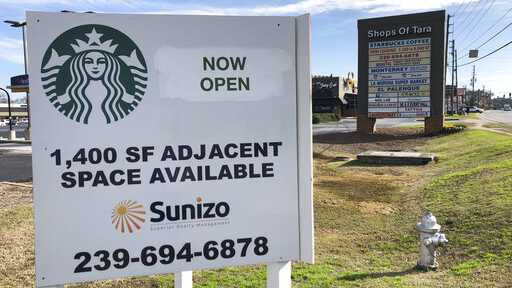 Signage is seen Jan. 16, 2019, in Jonesboro, Ga., for a Starbucks that has opened. Starbucks has a point to prove: There's more to the company than selling $4 lattes to rich people. Starbucks plans to open or remodel 85 stores by 2025 in rural and urban communities across the U.S.