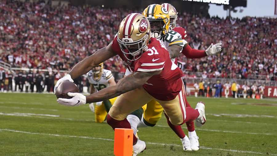 San Francisco 49ers running back Raheem Mostert (31) scores in front of Green Bay Packers free safety Darnell Savage during the first half of the NFL NFC Championship football game Sunday, Jan. 19, 2020, in Santa Clara, Calif.