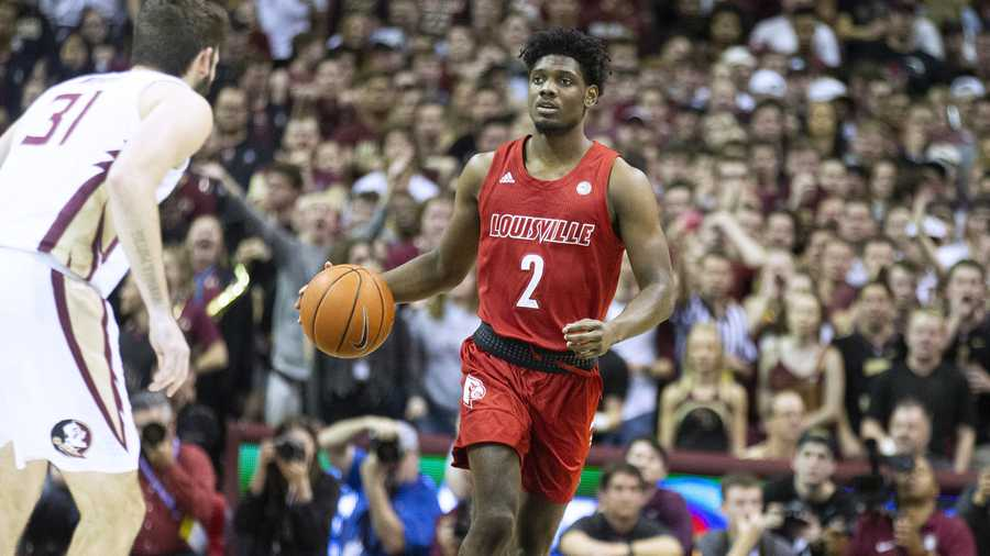 Louisville guard Darius Perry (2) brings the ball up court against Florida State in the first half of an NCAA college basketball game in Tallahassee, Fla., Monday, Feb. 24, 2020. (AP Photo/Mark Wallheiser)