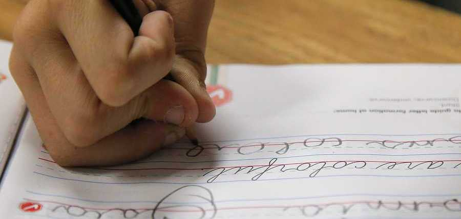A student practices writing in cursive at St. Mark's Lutheran School in Hacienda Heights, Calif., Thursday, Oct. 18, 2012.