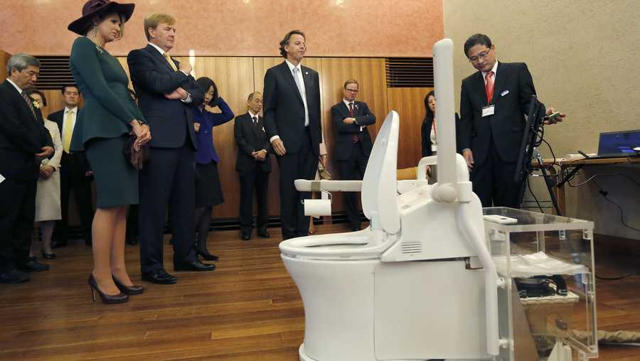 Here, Toto chief researcher Konosuke Matsushita, demonstrates some of the company's toilets at the University of Tokyo.