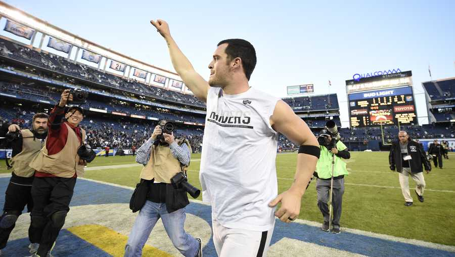 Oakland Raiders quarterback Derek Carr celebrates after an NFL football game against the San Diego Chargers Sunday, Dec. 18, 2016, in San Diego.