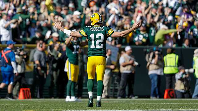 Green Bay Packers' Aaron Rodgers reacts after throwing a touchdown pass to Jake Kumerow during the first half of an NFL football game against the Oakland Raiders Sunday, Oct. 20, 2019, in Green Bay, Wis.