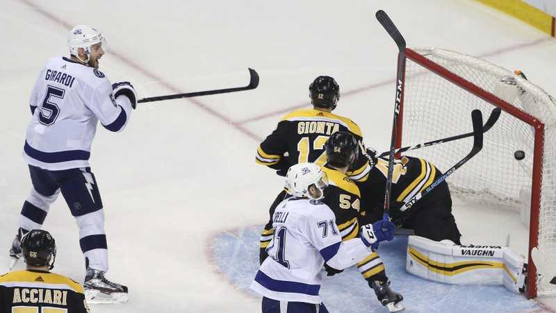 Tampa Bay Lightning defenseman Dan Girardi (5) starts to celebrate his goal against Boston Bruins goaltender Tuukka Rask (40) in overtime of Game 4 of an NHL hockey second-round playoff series Friday, May 4, 2018, in Boston. The Lightning won 4-3.