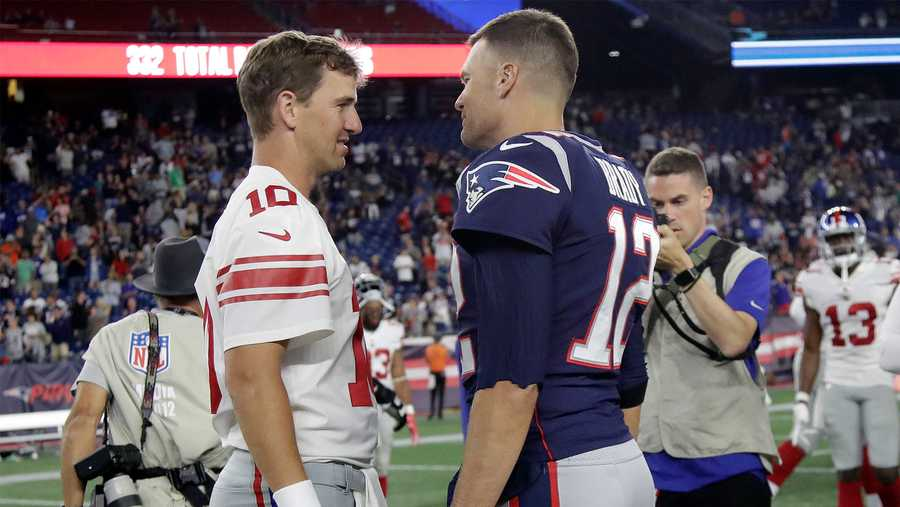 Eli Manning and Tom Brady talk after the New England Patriots played the New York Giants on Oct. 10, 2019.