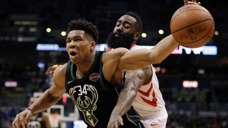Milwaukee Bucks' Giannis Antetokounmpo is fouled by Houston Rockets' James Harden during the second half of an NBA basketball game Wednesday, March 7, 2018, in Milwaukee. (AP Photo/Morry Gash)