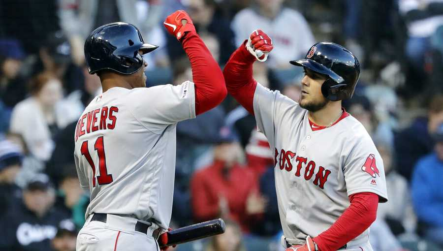 Boston Red Sox's Michael Chavis, right, celebrates with Rafael Devers after hitting a solo home run against the Chicago White Sox during the third inning of a baseball game in Chicago, Saturday, May 4, 2019. (AP Photo/Nam Y. Huh)