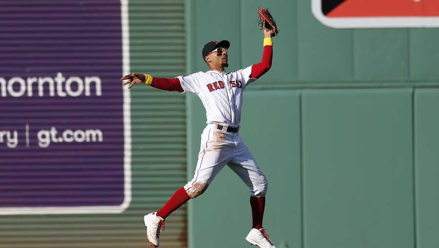 Boston Red Sox's Mookie Betts makes the catch on the line out by New York Yankees' Mike Tauchman during the fourth inning of a baseball game in Boston, Saturday, Sept. 7, 2019. (AP Photo/Michael Dwyer)