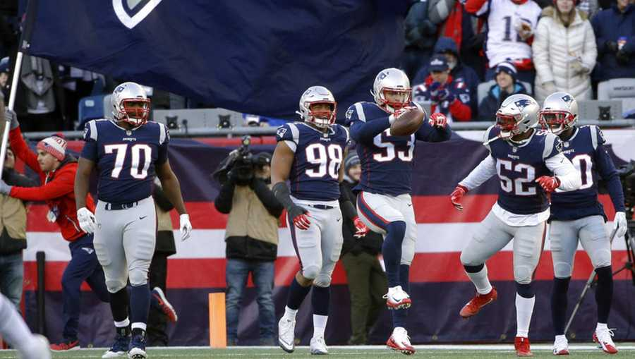 New England Patriots linebacker Kyle Van Noy (53) celebrates his touchdown run with teammates after recovering a fumble by New York Jets quarterback Sam Darnold during the second half of an NFL football game, Sunday, Dec. 30, 2018, in Foxborough, Mass. (AP Photo/Steven Senne)