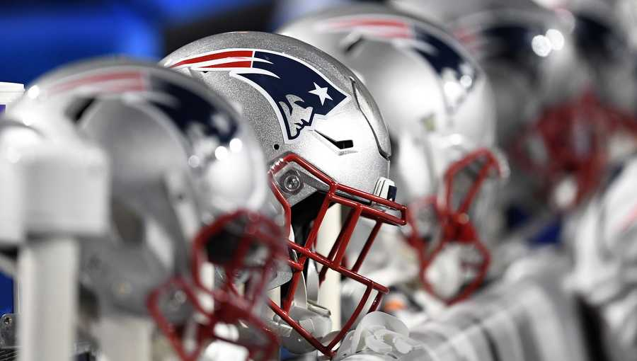 New England Patriots helmets sit on heaters along the bench during the second half of an NFL football game between the Buffalo Bills and the New England Patriots, Monday, Oct. 29, 2018, in Orchard Park, N.Y. The Patriots won 25-6. (AP Photo/Adrian Kraus)