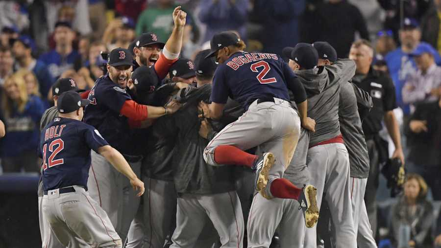 The Boston Red Sox celebrate after Game 5 of baseball's World Series against the Los Angeles Dodgers on Sunday, Oct. 28, 2018, in Los Angeles. The Red Sox won 5-1 to win the series 4 games to 1. (AP Photo/Mark J. Terrill)