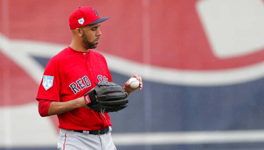 Boston Red Sox starting pitcher David Price looks at a ball as he warms up at the team's spring training baseball facility in Ft. Myers, Fla., Wednesday, Feb. 13, 2019. (AP Photo/Gerald Herbert)
