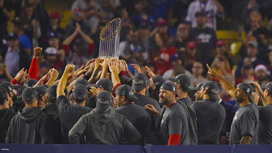 The Boston Red Sox hold the championship trophy after Game 5 of baseball's World Series against the Los Angeles Dodgers on Sunday, Oct. 28, 2018, in Los Angeles. The Red Sox won 5-1 to win the series 4 game to 1.
