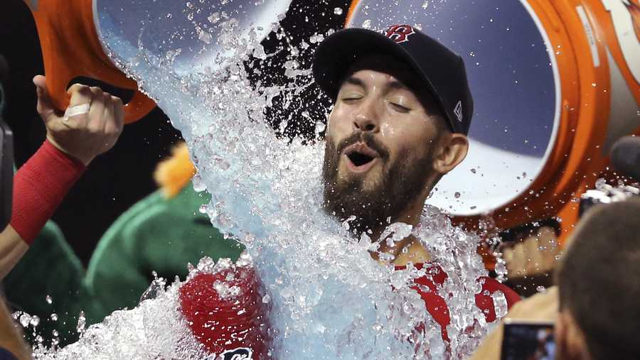 Boston Red Sox starting pitcher Rick Porcello is doused after he pitched a one-hitter against the New York Yankees in a baseball game at Fenway Park, Friday, Aug. 3, 2018, in Boston. The Red Sox won 4-1. (AP Photo/Elise Amendola)