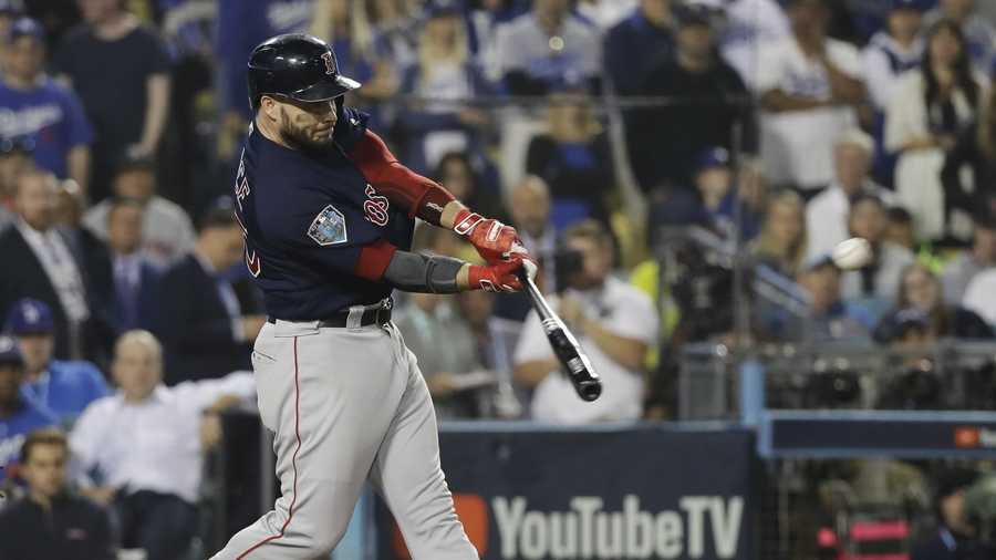 Boston Red Sox's Steve Pearce hits a three-run RBI double during the ninth inning in Game 4 of the World Series baseball game against the Los Angeles Dodgers on Saturday, Oct. 27, 2018, in Los Angeles. (AP Photo/David J. Phillip)