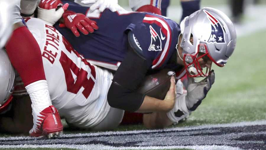 New England Patriot quarterback Tom Brady scores a touchdown in the second half of an NFL football game against the New York Giants, Thursday, Oct. 10, 2019, in Foxborough, Mass. (AP Photo/Charles Krupa)