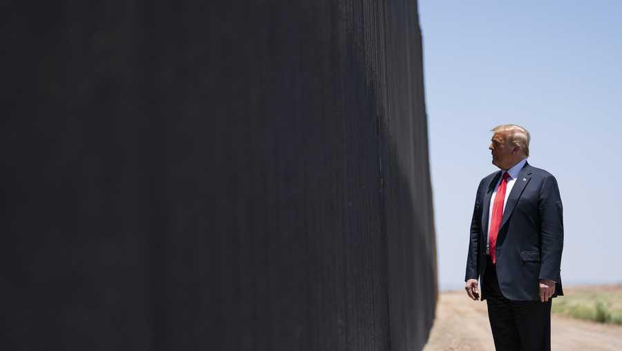 President Donald Trump tours a section of the border wall, Tuesday, June 23, 2020, in San Luis, Ariz.
