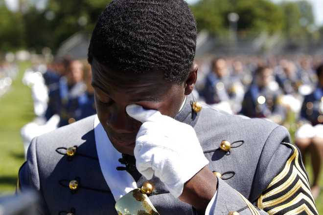 West Point Class President Cadet Joshua Phillips, from Chicago, wipes a tear during the musical performances portion of a commencement ceremony for the Class of 2020 on the parade field, at the United States Military Academy in West Point, N.Y., Saturday, June 13, 2020. (AP Photo/Alex Brandon)