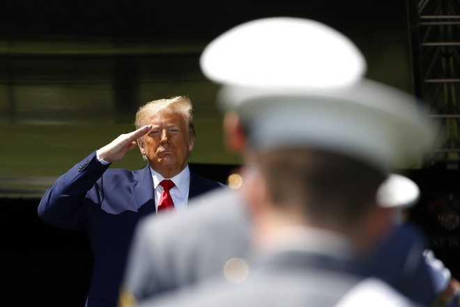 President Donald Trump salutes after speaking to over 1,110 cadets in the Class of 2020 at a commencement ceremony on the parade field, at the United States Military Academy in West Point, N.Y., Saturday, June 13, 2020.