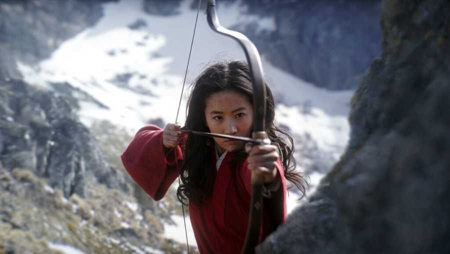 "This image released by Disney shows Yifei Liu in the title role of ""Mulan. Disney said Friday, June 26, 2020 that it would delay the release of the live-action adaptation until Aug, 21, 2020, after having already delayed its release from March until July because of the coronavirus pandemic."