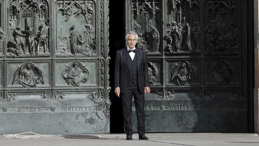 In this Sunday, April 12, 2020, Italian singer Andrea Bocelli performs outside the Duomo cathedral, in Milan, Italy.