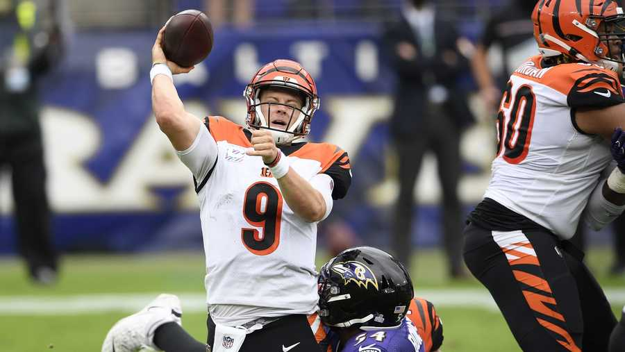 Baltimore Ravens linebacker Tyus Bowser, back, makes a hit on Cincinnati Bengals quarterback Joe Burrow as he tries a pass during the first half of an NFL football game, Sunday, Oct. 11, 2020, in Baltimore. (AP Photo/Nick Wass)