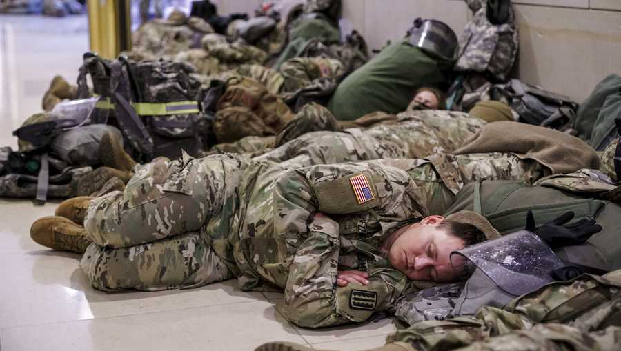 Hundreds of National Guard troops hold inside the Capitol Visitor's Center to reinforce security at the Capitol in Washington, Wednesday, Jan. 13, 2021.(AP Photo/J. Scott Applewhite)