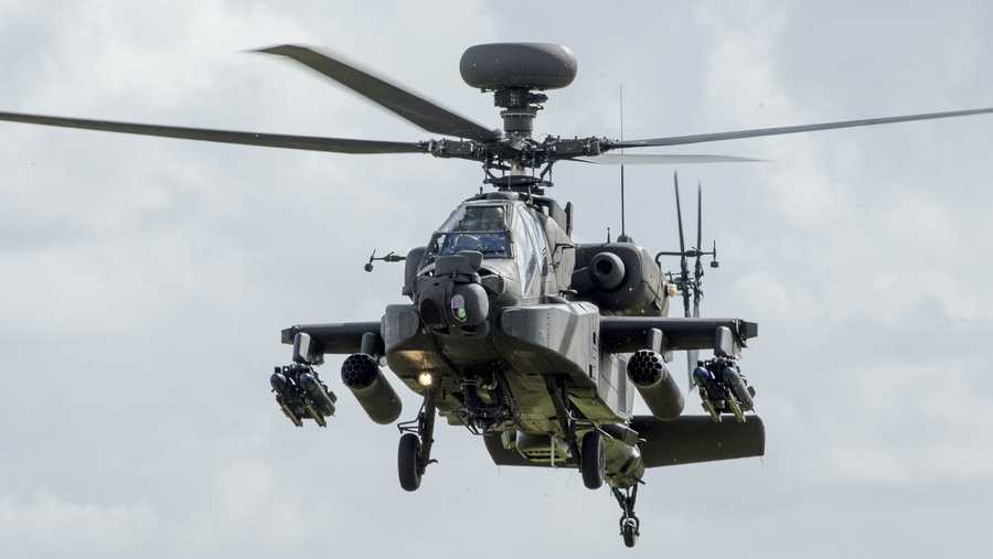 In this file photo, an Apache Helicopter performs a flypast at the Museum of Army Flying on March 16, 2018 in Stockbridge, England.
