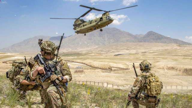Soldiers from 1st Battalion, 121st Infantry Regiment of the 48th Infantry Brigade Combat Team provide security as a CH-47 Chinook helicopter lands after a mission in southeastern Afghanistan. The 48th Infantry Brigade Combat Team deployed to Afghanistan earlier in 2019 in support of Operation Freedom's Sentinel.