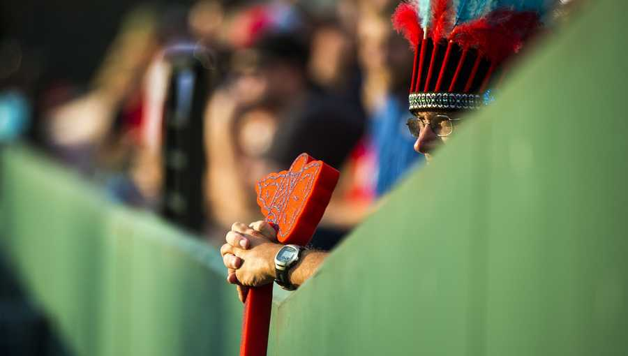 A Braves fan holds a foam tomahawk.