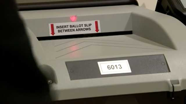 An electronic ballot machine is shown where voters' ballots are recorded.