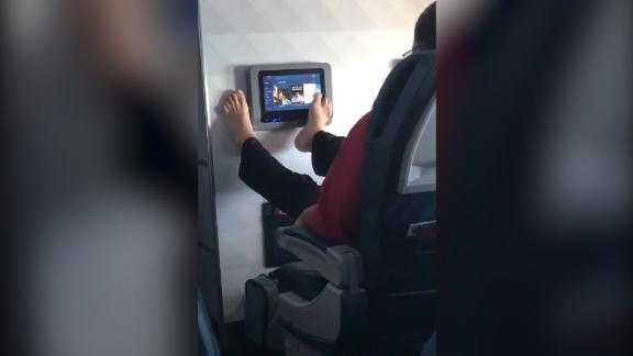 This video of a passenger operating his seatback TV with his bare feet has gone viral.