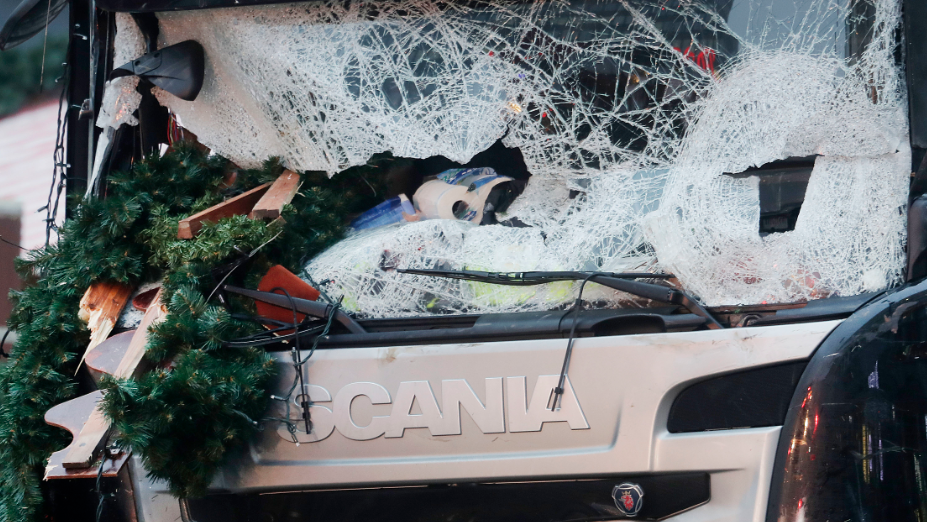 Christmas decoration sticks in the smashed window of the cabin of a truck which ran into a crowded Christmas market Monday evening killing several people in Berlin, Germany, Tuesday, Dec. 20, 2016.
