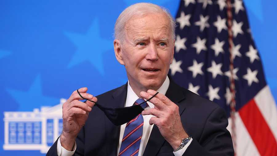 U.S. President Joe Biden replaces his face mask following an Equal Pay Day event in the South Court Auditorium in the Eisenhower Executive Office Building on March 24, 2021 in Washington, DC.
