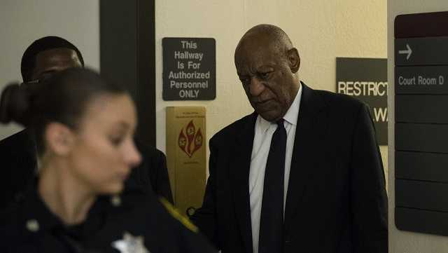 Bill Cosby walks to the courtroom during a break in his sexual assault trial at the Montgomery County Courthouse in Norristown, Pa., Tuesday, June 6, 2017.