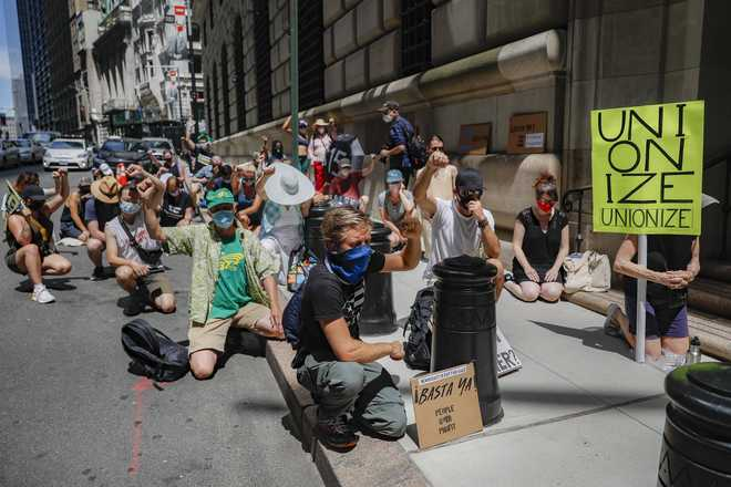 Protesters gather for a rally outside the Federal Reserve in the Financial District, Monday, July 20, 2020, in the Manhattan borough of New York.