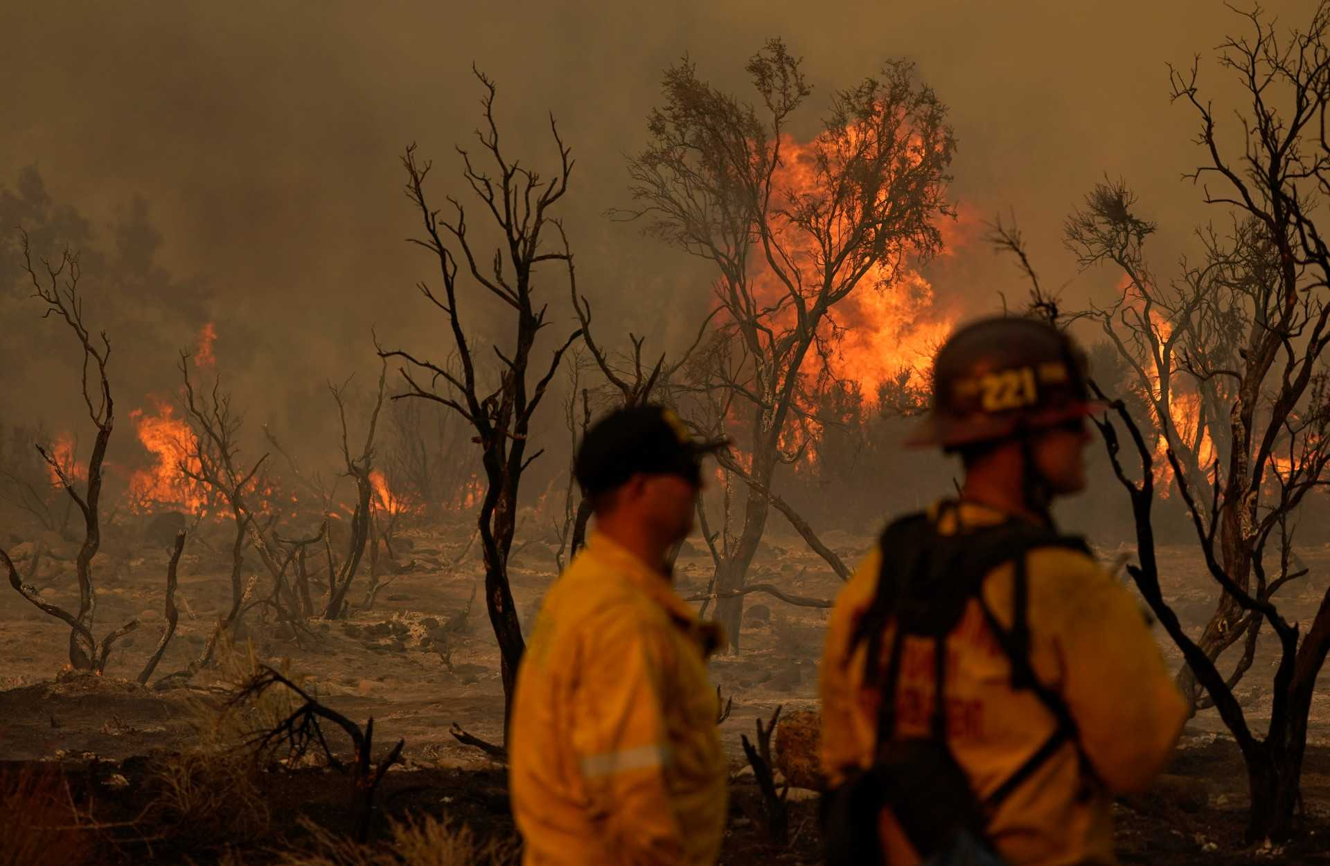 Desert communities told to evacuate as winds stoke California flames