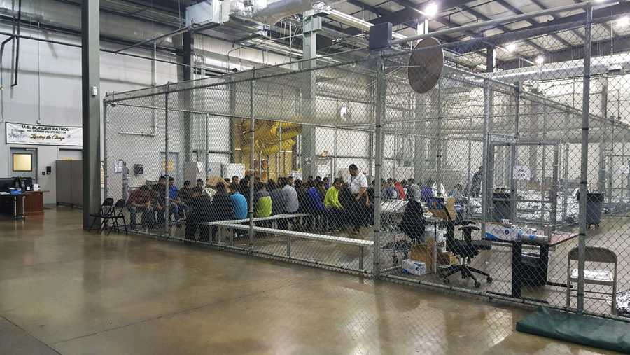 In this photo provided by U.S. Customs and Border Protection, people who've been taken into custody related to cases of illegal entry into the United States, sit in one of the cages at a facility in McAllen, Texas, Sunday, June 17, 2018