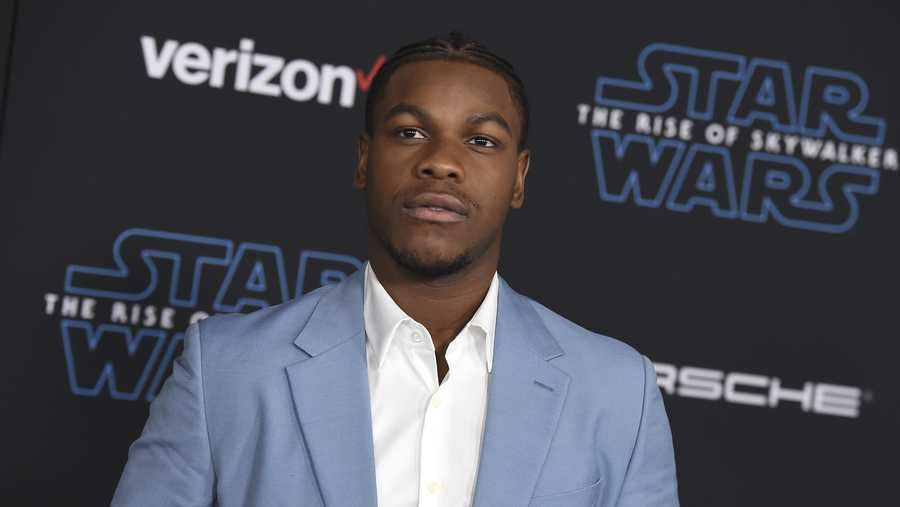 "In this Monday, Dec. 16, 2019 file photo, John Boyega arrives at the world premiere of ""Star Wars: The Rise of Skywalker"" in Los Angeles. British perfume brand Jo Malone has apologized to Black actor John Boyega of ""Star Wars"" fame after cutting him out of the Chinese version of a cologne commercial he helped create."