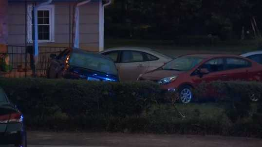 Suspect driver hits person, then hits house