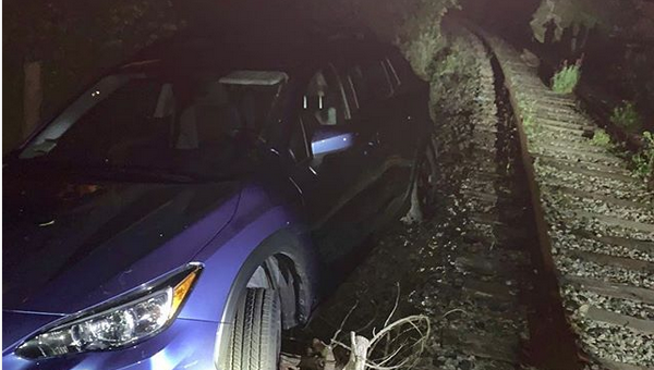 Man arrested after driving on train tracks