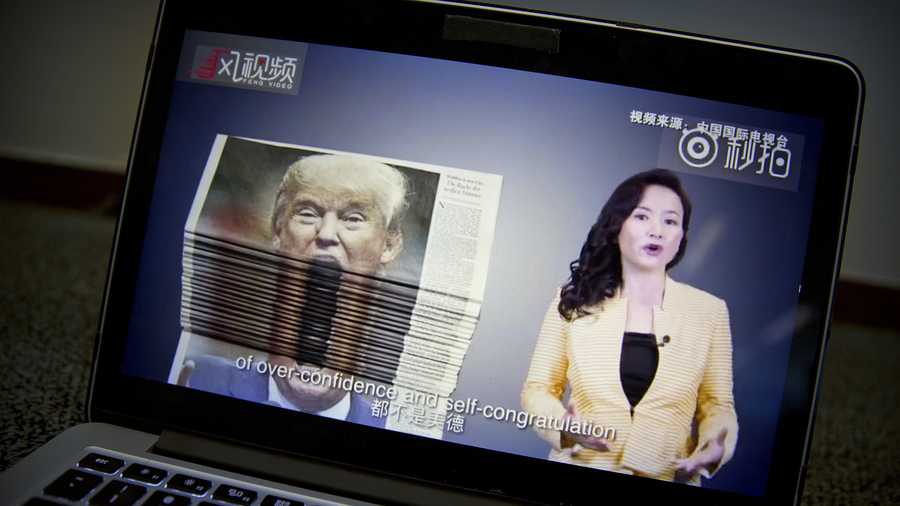 An online video about U.S.-China trade tensions produced by China's state television broadcaster plays on a computer screen in Beijing, China, Thursday, Aug. 23, 2018.