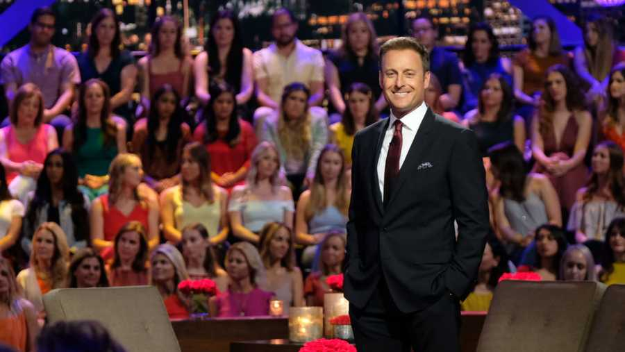 "Host Chris Harrison is shown before a crowd in July 2019 for ""The Bachelorette: Season Finale Part 2."""