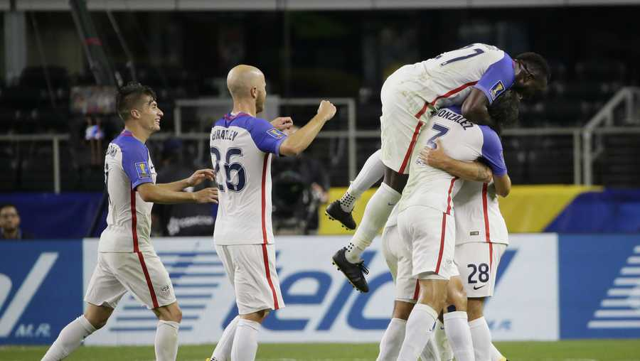 United States' Clint Dempsey is congratulated by teammates after scoring a goal against Costa Rica during a CONCACAF Gold Cup semifinal soccer match in Arlington, Texas, Saturday, July 22, 2017.