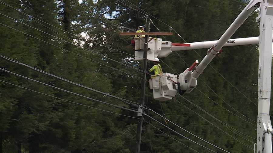 File photo of CMP crews working to restore power.