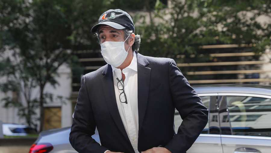 In this May 21, 2020 file photo, Michael Cohen arrives at his Manhattan apartment in New York after being furloughed from prison because of concerns over the coronavirus.